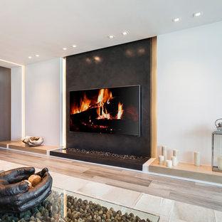 マイアミの中くらいのコンテンポラリースタイルのおしゃれなLDK (フォーマル、黒い壁、セラミックタイルの床、吊り下げ式暖炉、石材の暖炉まわり、埋込式メディアウォール、グレーの床) の写真