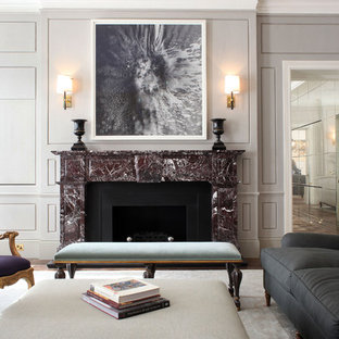 Inspiration for a traditional formal enclosed living room in London with grey walls, dark hardwood flooring, a standard fireplace and brown floors.