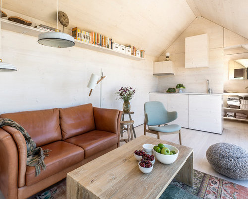 Inspiration For A Small Scandinavian Formal Light Wood Floor Living Room Remodel In Madrid With Beige