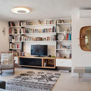 Ejemplo de biblioteca en casa abierta, contemporánea, pequeña, sin televisor, con paredes blancas y suelo de travertino