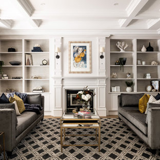 Inspiration for a traditional living room in Perth with grey walls, medium hardwood floors, a standard fireplace and brown floor.