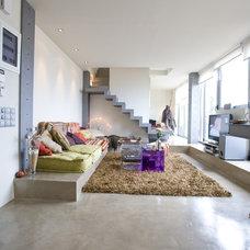 Contemporary Living Room by Kourasanit Nola Inc