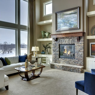 Living room - large contemporary open concept living room idea in New York with beige walls, a standard fireplace, a stone fireplace and no tv