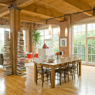 Inspiration for a modern open concept living room library remodel in San Francisco with red walls