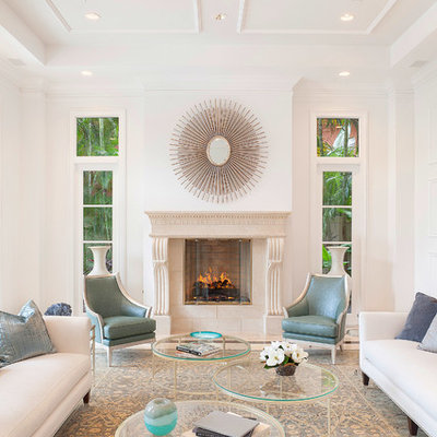 Inspiration for a transitional formal living room remodel in Miami with white walls and a standard fireplace