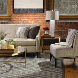 Modelo de salón para visitas cerrado, industrial, de tamaño medio, sin chimenea y televisor, con paredes rojas y suelo de madera en tonos medios