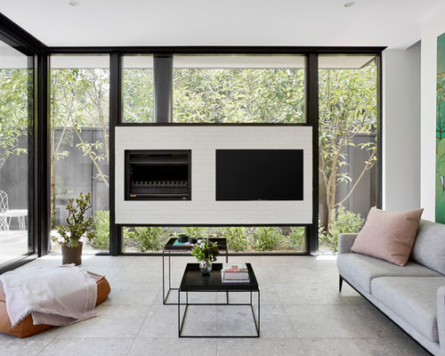 Contemporary Living Room Designs. Contemporary living room in Melbourne with white walls and a wall mounted  tv Living Room Design Ideas Renovations Photos