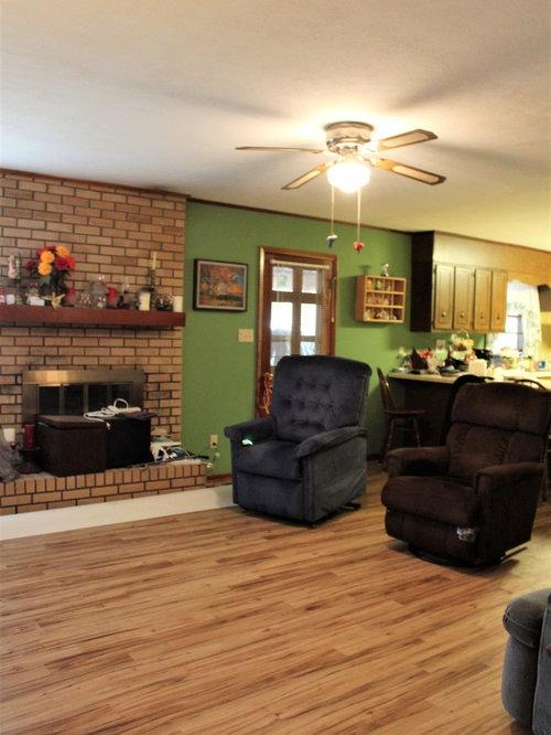 Wohnzimmer mit vinylboden und gr ner wandfarbe ideen for Wandfarbe kamin