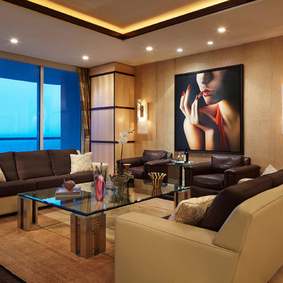 Example of a large trendy formal and enclosed light wood floor living room design in Miami with beige walls, no fireplace and no tv