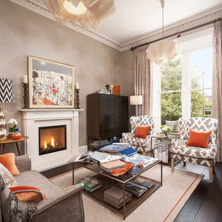 Inspiration for a traditional formal enclosed living room in Edinburgh with beige walls, dark hardwood flooring, a standard fireplace, brown floors and a concrete fireplace surround.