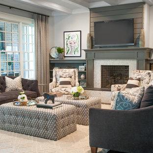 Foto de salón abierto, clásico renovado, grande, con paredes grises, suelo de madera oscura, chimenea tradicional, marco de chimenea de baldosas y/o azulejos, televisor colgado en la pared y suelo marrón