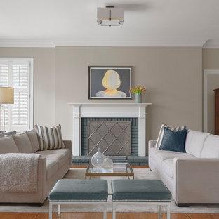セントルイスのトランジショナルスタイルのおしゃれな独立型リビング (フォーマル、ベージュの壁、無垢フローリング、標準型暖炉、レンガの暖炉まわり、テレビなし、オレンジの床) の写真