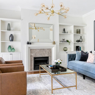 Design ideas for a transitional living room in Sydney with white walls, medium hardwood floors, a standard fireplace, a stone fireplace surround and brown floor.