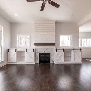 Living room - transitional open concept dark wood floor, brown floor and shiplap wall living room idea in Louisville with white walls, a standard fireplace and a shiplap fireplace