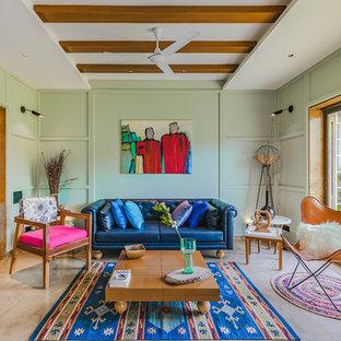Ejemplo de salón de estilo zen con paredes verdes y suelo beige