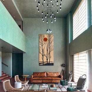 Immagine di un grande soggiorno minimal aperto con pareti verdi e sala formale