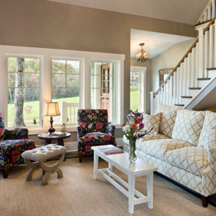 Mid-sized traditional open concept living room in Other with brown walls, dark hardwood floors, no fireplace and a concealed tv.