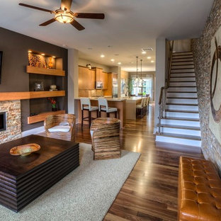 Photo of a traditional open concept living room in Atlanta with a ribbon fireplace and a wall-mounted tv.