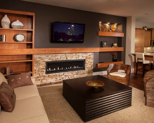 Example Of A Trendy Open Concept Living Room Design In Atlanta With Ribbon Fireplace And