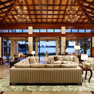 Esempio di un grande soggiorno etnico chiuso con sala formale, pareti beige, pavimento in gres porcellanato, nessun camino, nessuna TV e pavimento beige