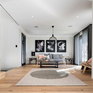 This is an example of an asian formal open concept living room in Perth with grey walls, light hardwood floors and beige floor.