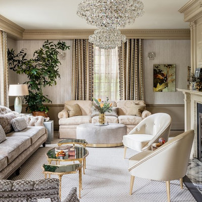 Elegant formal and enclosed carpeted and gray floor living room photo in Orlando with beige walls and a standard fireplace