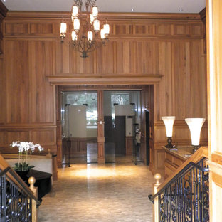 This is an example of a large traditional formal enclosed living room in Atlanta with brown walls, limestone flooring, no fireplace and no tv.