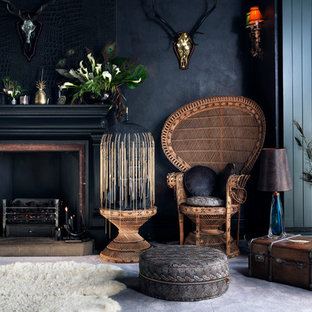 Eclectic formal and enclosed living room photo in Cornwall with black walls and a standard fireplace