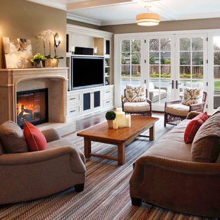Inspiration for a classic living room in San Francisco with a standard fireplace and a built-in media unit.