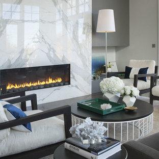 カルガリーの中くらいのコンテンポラリースタイルのおしゃれなリビング (フォーマル、マルチカラーの壁、カーペット敷き、横長型暖炉、石材の暖炉まわり) の写真