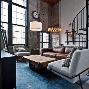 アトランタの中サイズのインダストリアルスタイルのおしゃれなLDK (白い壁、コンクリートの床、グレーの床、暖炉なし、据え置き型テレビ) の写真