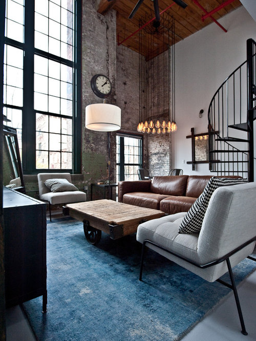 mid sized urban open concept concrete floor and gray floor living room photo in atlanta - Industrial Living Room Decor
