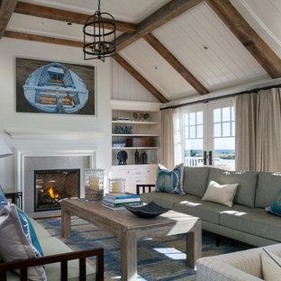 ボストンの広いビーチスタイルのおしゃれなLDK (フォーマル、標準型暖炉、白い壁、無垢フローリング、コンクリートの暖炉まわり) の写真