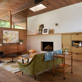 Living room - 1950s open concept medium tone wood floor and brown floor living room idea in San Francisco with white walls, a two-sided fireplace and a tile fireplace