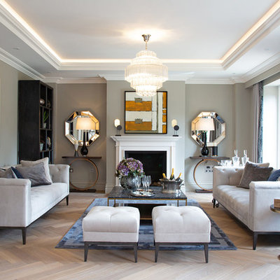 Living room - contemporary formal light wood floor living room idea in London with gray walls, a standard fireplace and no tv