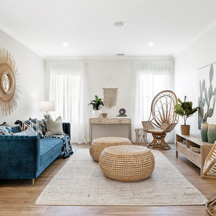 Design ideas for a beach style living room in Melbourne with grey walls, medium hardwood floors and brown floor.