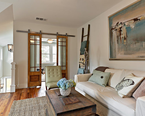 Example Of A Transitional Loft Style Living Room Design In Austin With White Walls