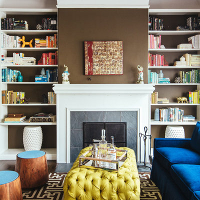 Mid-sized trendy living room library photo in San Francisco with brown walls, a standard fireplace and a stone fireplace
