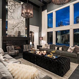 Inspiration för mycket stora klassiska separata vardagsrum, med en spiselkrans i trä, svarta väggar, en bred öppen spis, svart golv och vinylgolv