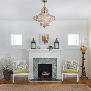 Inspiration for a small shabby-chic style formal living room in Jacksonville with white walls, medium hardwood flooring, a standard fireplace and a tiled fireplace surround.