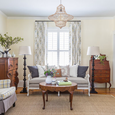 Living room - shabby-chic style formal medium tone wood floor living room idea in Jacksonville with yellow walls
