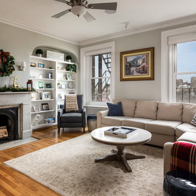 Example of a transitional living room design in Boston with a standard fireplace