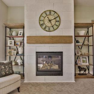 ウィチタの中サイズのカントリー風おしゃれなLDK (緑の壁、カーペット敷き、標準型暖炉、コンクリートの暖炉まわり、壁掛け型テレビ、グレーの床) の写真