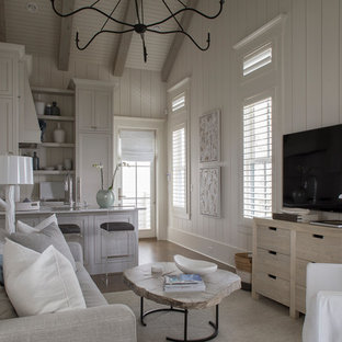 Inspiration for a small beach style open concept dark wood floor and brown floor living room remodel in Miami with white walls, no fireplace and a wall-mounted tv
