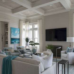 Living room - beach style dark wood floor and brown floor living room idea in Miami with white walls and a standard fireplace