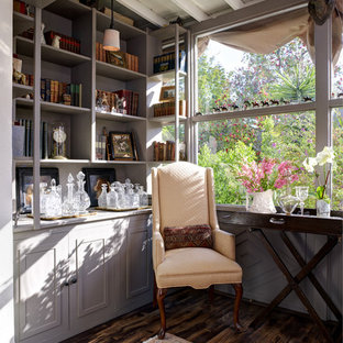 Inspiration for a traditional living room in Los Angeles with a library and purple walls.