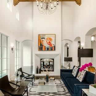 Ejemplo de salón mediterráneo, sin televisor, con paredes blancas, suelo de madera oscura y chimenea tradicional