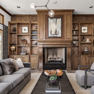 Example of a transitional living room library design in Phoenix with a standard fireplace