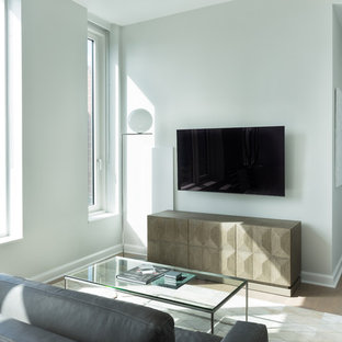Medium sized modern open plan living room in New York with grey walls and a wall mounted tv.