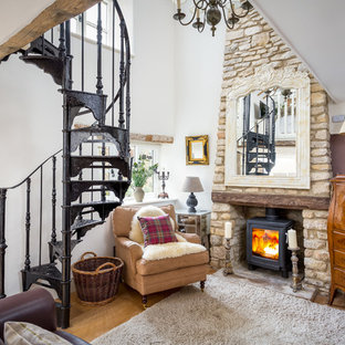 Design ideas for a medium sized country living room in Gloucestershire with white walls, light hardwood flooring and a wood burning stove.